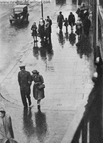 A G.I.'s Afternoon Off in the Rainy Streets of Warrington Sensational tales are told of their behaviour. But there is no sensation here. Only a normal desire to enjoy life on the part of six thousand Americans who have little opportunity.
