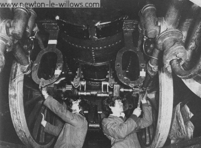 The re-assembly of Lion's motion at Vulcan Works in 1979. Gerry Moylan (left) and Philip Franklin (right), of the Lion project team are seen at work. Ruston Diesels Ltd