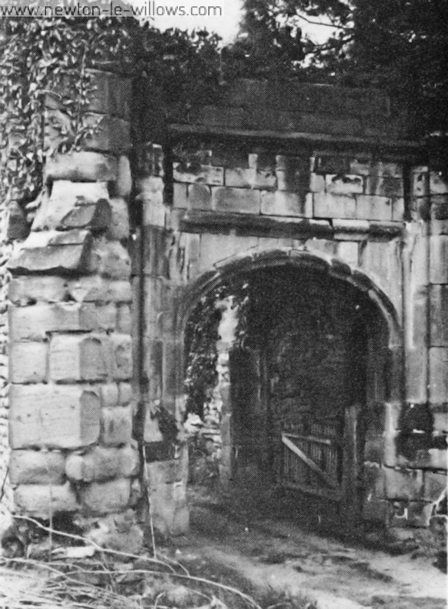 All that remains of the entrance to Bradleigh Hall—once the Manor House of Burtonwood—with the original cobbles still visible.